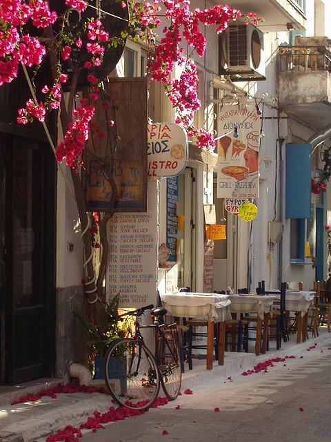 A lonely bike waits outside a taverna in Koroni, Greece
