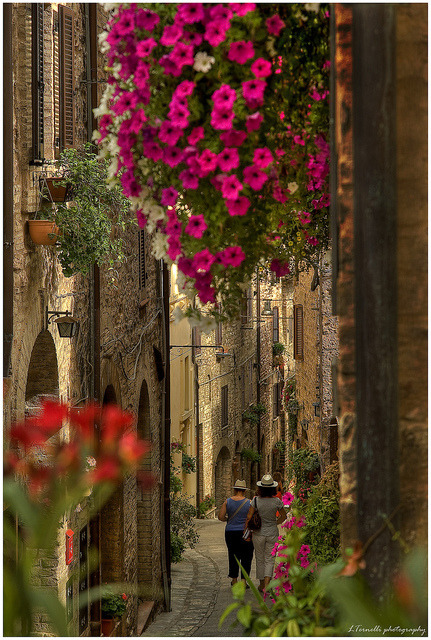 Strolling on the beautiful streets of Spello in Umbria, Italy