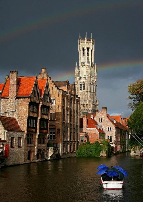 Rainbows above the belfry in Bruges, Belgium