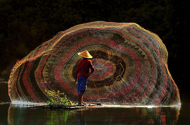Fisherman at work, Depok Lake, Indonesia
